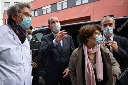 French Prime Minister Jean Castex (2-L) arrives with Mayor of Lille Martine Aubry (2-R) and General Director of Lille's CHU Frederic Boiron (R) at the Centre Hospitalier Universitaire (CHU) during his visit in Lille, France, 16 October 2020.