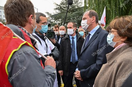 French Prime Minister Jean Castex (C-R) and Mayor of Lille Martine Aubry (R) speak with members of the CGT trade union as he arrives at the Centre Hospitalier Universitaire (CHU) during his visit in Lille, France, 16 October 2020.