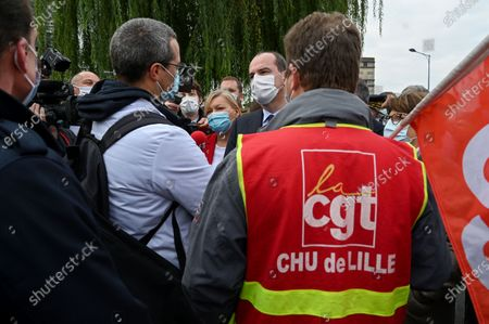 French Prime Minister Jean Castex (C) and Mayor of Lille Martine Aubry (R) speak with members of the CGT trade union as he arrives at the Centre Hospitalier Universitaire (CHU) during his visit in Lille, France, 16 October 2020.