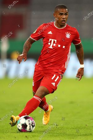 Stock Photo of Bayern's Douglas Costa controls the ball during the 1st round German Soccer Cup match between FC Bayern Munich and FC Duren, at the Allianz Arena in Munich, Germany