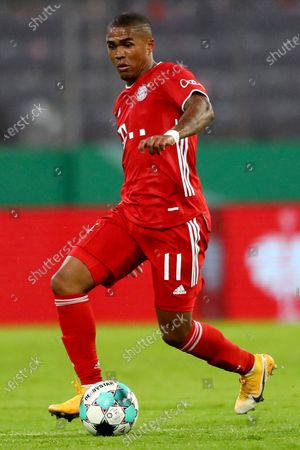 Stock Picture of Bayern's Douglas Costa controls the ball during the 1st round German Soccer Cup match between FC Bayern Munich and FC Duren, at the Allianz Arena in Munich, Germany