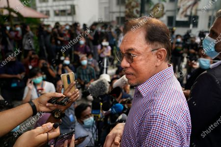 Malaysian opposition leader Anwar Ibrahim speaks to media after come out from police headquarters in Kuala Lumpur, Malaysia, . Anwar questioned by police over the dissemination of a purported list of lawmakers supporting his bid to oust the government