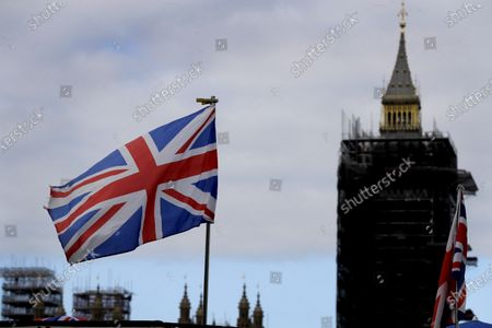 """The Union flag flies above a souvenir stand in front of Big Ben in London, . Britain's foreign minister says there are only narrow differences remaining in trade talks between the U.K. and the European Union. But Dominic Raab insists the bloc must show more """"flexibility"""" if it wants to make a deal"""