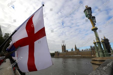 """The English flag flies above a souvenir stand opposite Britain's Parliament in London, . Britain's foreign minister says there are only narrow differences remaining in trade talks between the U.K. and the European Union. But Dominic Raab insists the bloc must show more """"flexibility"""" if it wants to make a deal"""