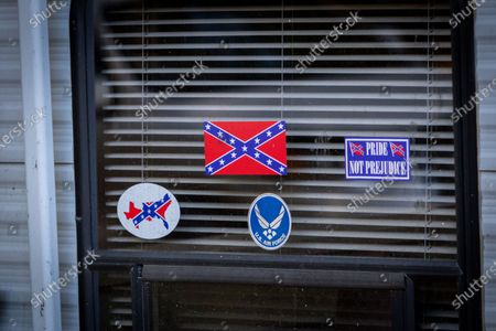 Confederate flag and Air Force stickers decorate the window where FBI agents raided this secluded camp on 7 October, 2020 in Luther, Michigan used by militia members for planning, explosives detonation, and other weapons training in connection with a plot to kidnap Michigan Governor Gretchen Whitmer and Virginia Governor Ralph Northam.