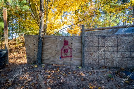 Silhouettes of people are painted on the wall to test the amount of damage an IED might inflict when set off. FBI agents raided this secluded camp on 7 October, 2020 in Luther, Michigan used by militia members for planning, explosives detonation, and other weapons training in connection with a plot to kidnap Michigan Governor Gretchen Whitmer and Virginia Governor Ralph Northam.