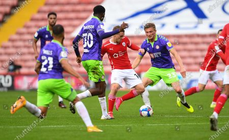 Luke Thomas of Barnsley with Tyreeq Bakinson and Taylor Moore of Bristol City