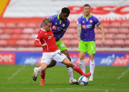 Luke Thomas of Barnsley and Tyreeq Bakinson of Bristol City