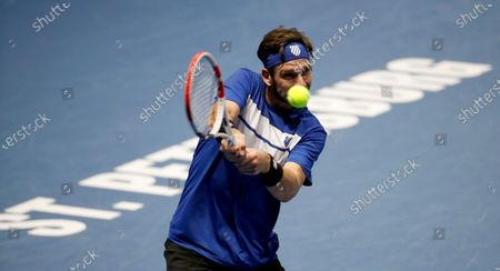 Cameron Norrie of Great Britain in action against Andrey Rublev of Russia during their quarter final match of the St.Petersburg Open ATP tennis tournament in St.Petersburg, Russia, 16 October 2020.