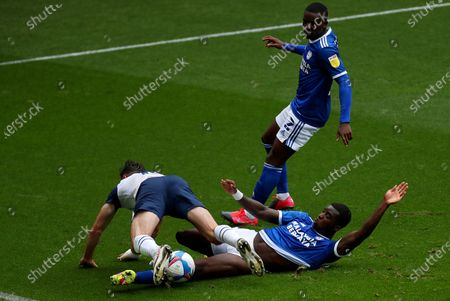 Ben Davies of Preston North End is tackled by Jordi Osei-Tutu of Cardiff City