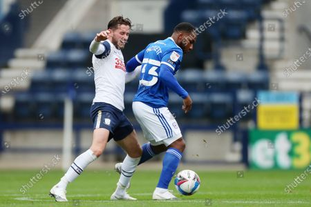 Alan Browne of Preston North End and Junior Hoilett of Cardiff City