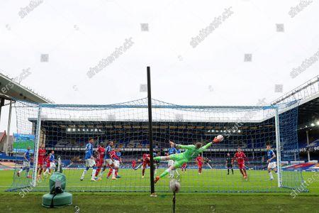 Everton goalkeeper Jordan Pickford saves the header at goal by Fabinho of Liverpool