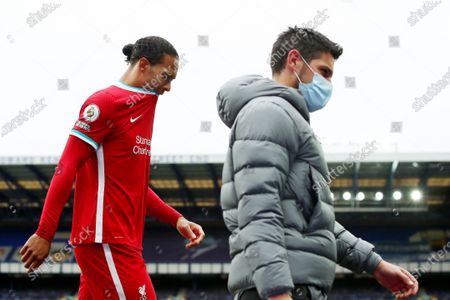 Stock Photo of Virgil van Dijk of Liverpool shows a look of dejection as he heads back to the dressing room after being substituted through injury