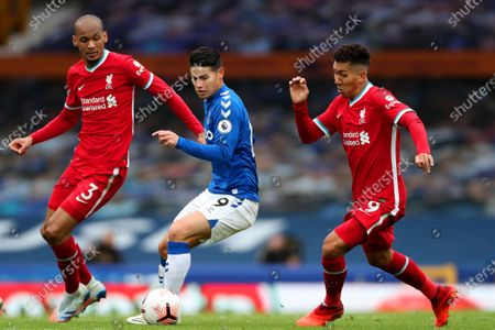 James Rodriguez of Everton competes with Fabinho and Roberto Firmino of Liverpool
