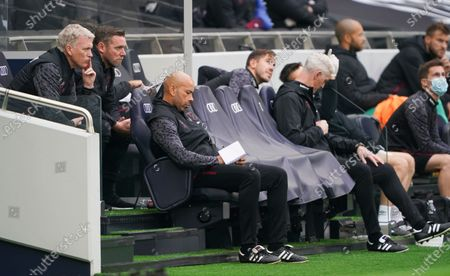 West Ham manager David Moyes looks on with his coaching staff including Kevin Nolan and Paul Nevin
