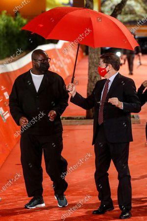 Steve McQueen (L) and Rome Film Festival Artistic Director Antonio Monda (R) arrive for the screening of his mini-series 'Small Axe' at the 15th annual Rome International Film Festival, in Rome, Italy, 16 October 2020. The film festival runs from 15 to 25 October.