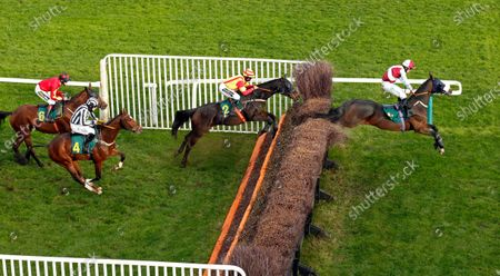 SIR JACK YEATS (right, James Bowen) leads PRINCETON ROYALE (centre) and FIXED RATE (left) in The Download The At The Races App Handicap Chase Fakenham