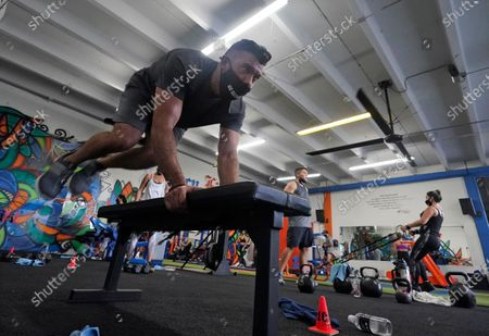 Jorge Garcia works out, at Legacy Fit in the Wynwood Art District of Miami. As the vast majority of in-person fitness clubs switched to virtual classes when the pandemic hit, Legacy Fit took the opposite approach
