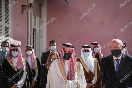 Portuguese Foreign Minister Augusto Santos Silva (R) accompanies by Saudi Foreign Minister Prince Faisal bin Farhan Al-Saud (C) after a meeting at Necessidades Palace, in Lisbon, Portugal, 16 October 2020.