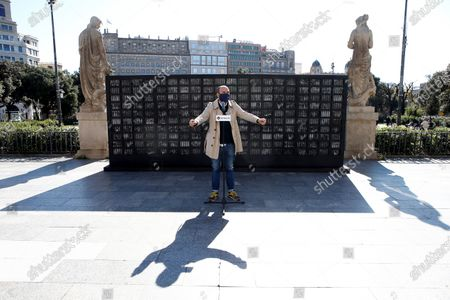 Vice chairman of Catalan pro-independent group Omnium Cultural, Marcel Mauri, speaks during the presentation of the symbolic artistic installation set by Omnium at the Catalunya square in Barcelona on the occasion of the third anniversary of the imprisonment of pro-independent leaders Jordi Cuixart and Jordi Sanchez, in Barcelona, Spain, 16 October 2020. The installation denounces the existence of 2,850 imprisoned pro-independent Catalan people due to what Omnium considers a political repression.
