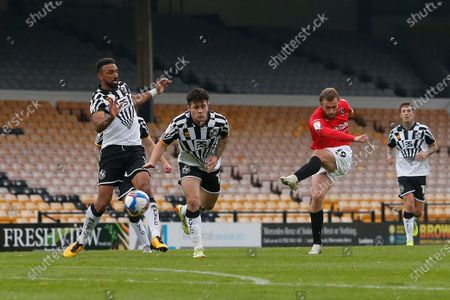 Salford City's James Wilson shoots