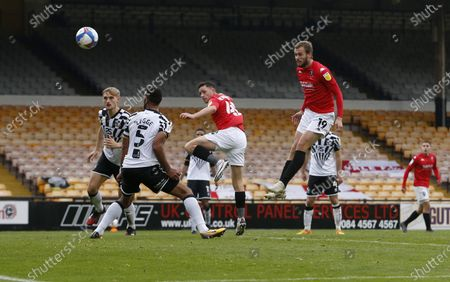 Salford City's James Wilson heads at goal