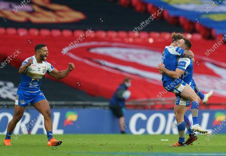 Luke Gale of Leeds Rhinos lifts Richie Myler of Leeds Rhinos as they celebrate at full-time