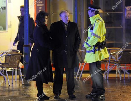 George, played by Anthony Valentine and Eve, played by Sabina Franklyn, are questioned by police.
