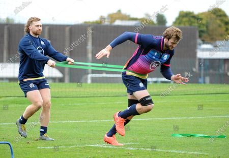 Richie Gray - Scotland lock (R) during the warm up with the assistance of flanker Tom Gordon.