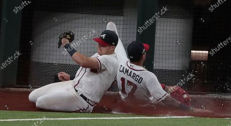 Stock Image of Arlington, Texas, Wednesday, October 14, 2020. Atlanta Braves;left fielder Austin Riley (27) nearly collides with Johan Camargo on a foul fly by Los Angeles Dodgers left fielder Joc Pederson (31) in game three of the NLCS at Globe Life Field. (Robert Gauthier/ Los Angeles Times)