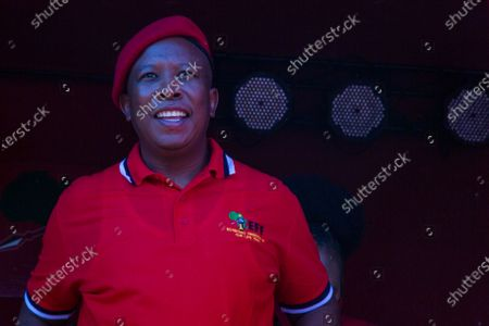 EFF leader Julius Malema outside the the magistrates court during the protest. A tense standoff between white farmers and Black activists gripped the South African town of Senekal, as two men accused of killing a white farm manager were to appear in court. More than 100 police patrolled the area in front of the courthouse in the Free State province and used barbed wire to separate the rival groups.