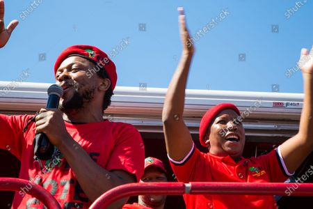 EFF leader Julius Malema (R) and a member of the Economic Freedom Fighters (EFF) chant slogans outside the the magistrates court during the protest. A tense standoff between white farmers and Black activists gripped the South African town of Senekal, as two men accused of killing a white farm manager were to appear in court. More than 100 police patrolled the area in front of the courthouse in the Free State province and used barbed wire to separate the rival groups.