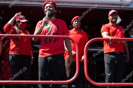 EFF leader Julius Malema and members of the Economic Freedom Fighters (EFF) chant slogans outside the the magistrates court during the protest. A tense standoff between white farmers and Black activists gripped the South African town of Senekal, as two men accused of killing a white farm manager were to appear in court. More than 100 police patrolled the area in front of the courthouse in the Free State province and used barbed wire to separate the rival groups.