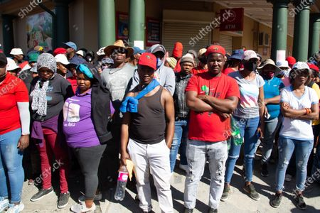 Members of the Economic Freedom Fighters (EFF) and Julius Malema supporters standing outside the magistrates court during the protest. A tense standoff between white farmers and Black activists gripped the South African town of Senekal, as two men accused of killing a white farm manager were to appear in court. More than 100 police patrolled the area in front of the courthouse in the Free State province and used barbed wire to separate the rival groups.