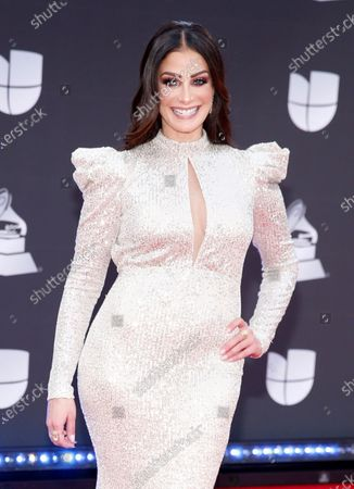 Dayanara Torres arrives at the 20th Latin Grammy Awards in Las Vegas on . Torres, who is a stage 3 metastatic Melanoma survivor, is part of the Melanoma Research Foundation's #GetNaked awareness and prevention campaign
