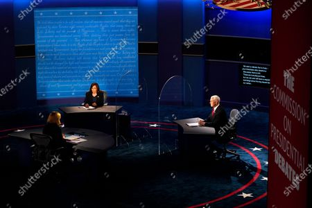 Democratic vice presidential candidate Sen. Kamala Harris, D-Calif., and Vice President Mike Pence listen to moderator Susan Page, Washington Bureau Chief for USA Today, during the vice presidential debate, at Kingsbury Hall on the campus of the University of Utah in Salt Lake City