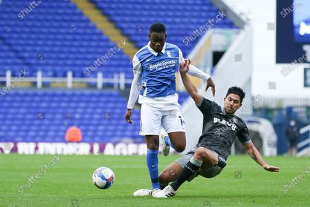 Jonathan Leko (14) of Birmingham City is tackled by Massimo Luongo (21) of Sheffield Wednesday