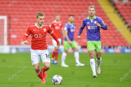 Luke Thomas (16) of Barnsley FC in action