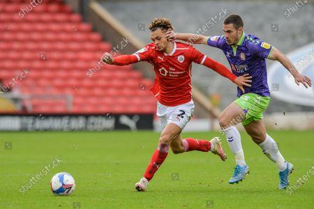 Jordan Williams (2) of Barnsley FC takes on Tommy Rowe (25) of Bristol City
