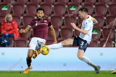 Jordan Roberts (#11) of Heart of Midlothian FC and Jordan McGhee (#3) of Dundee FC contest a ball during the SPFL Championship match between Heart of Midlothian and Dundee at Tynecastle Park, Edinburgh