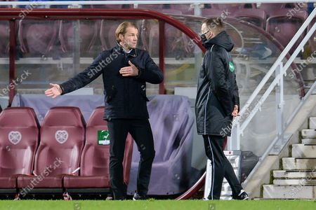 Heart of Midlothian manager Robbie Neilson speaks with fourth official, Calum Scott during the SPFL Championship match between Heart of Midlothian and Dundee at Tynecastle Park, Edinburgh