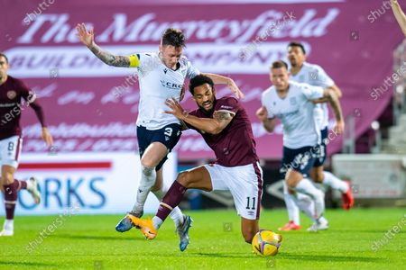 Jordan Roberts (#11) of Heart of Midlothian FC holds off Jordan McGhee (#3) of Dundee FC during the SPFL Championship match between Heart of Midlothian and Dundee at Tynecastle Park, Edinburgh