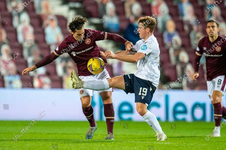 Finlay Robertson (#19) of Dundee FC tackles Jamie Walker (#7) of Heart of Midlothian FC during the SPFL Championship match between Heart of Midlothian and Dundee at Tynecastle Park, Edinburgh