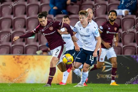 Jamie Walker (#7) of Heart of Midlothian FC and Finlay Robertson (#19) of Dundee FC tussle for the ball during the SPFL Championship match between Heart of Midlothian and Dundee at Tynecastle Park, Edinburgh