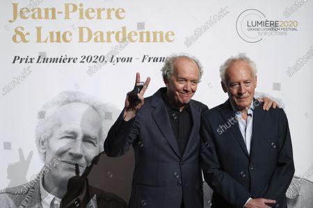 Belgian directors Luc and Jean-Pierre Dardenne pose for photographers as they arrive at the Lumiere Award ceremony of the 12th Lumiere Festival, in Lyon, central France