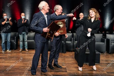 Belgian directors Luc and Jean-Pierre Dardenne celebrate with Belgian actress Emilie Dequenne after receiving their Awards during the Lumiere Award ceremony of the 12th Lumiere Festival, in Lyon, central France