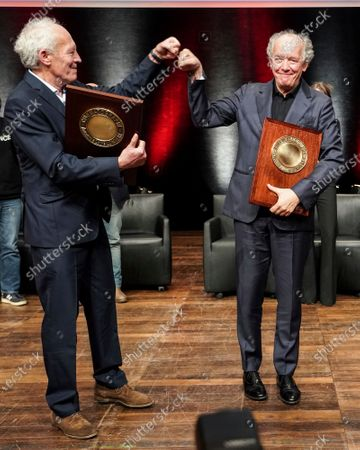 Belgian directors Luc and Jean-Pierre Dardenne celebrate after receiving their Awards during the Lumiere Award ceremony of the 12th Lumiere Festival, in Lyon, central France
