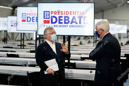 Nashville Mayor John Cooper, left, and Dr. Bob Fisher, right, president of Belmont University, speak, in the media tent set up on the school's campus for the presidential debate in Nashville, Tenn. The final debate between President Donald Trump and former Vice President Joe Biden is scheduled to be held at Belmont University on Oct. 22