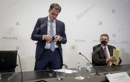 Belgium Prime Minister Alexander De Croo and Belgium Flemish minister-president Jan Jambon (R) give a press conference after a committee to discuss new restrictive measures after a spike of coronavirus disease (COVID-19) infections in the country, in Brussels, Belgium, 16 October 2020.
