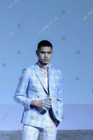A model presents a creation by Portuguese designer Miguel Vieira during the Portugal Fashion show in Porto, Portugal, 16 October 2020. Spring/Summer 2021 collections are presented at the 47th Portugal Fashion until 17 October.
